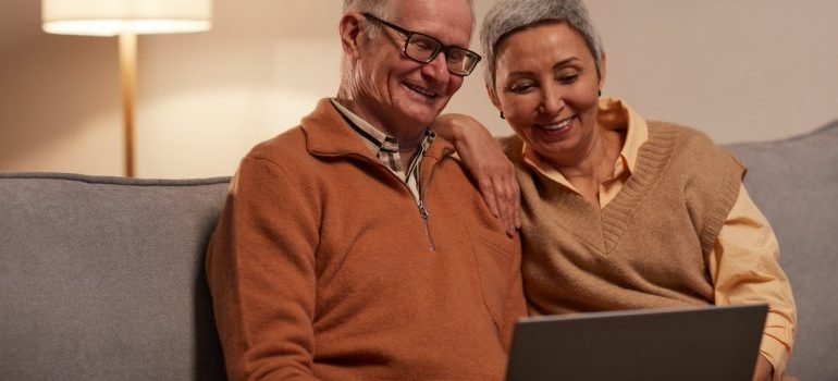 couple looking at recommendation for movers Aventura FL on their laptop