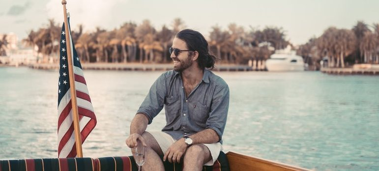 A guy sitting on a boat