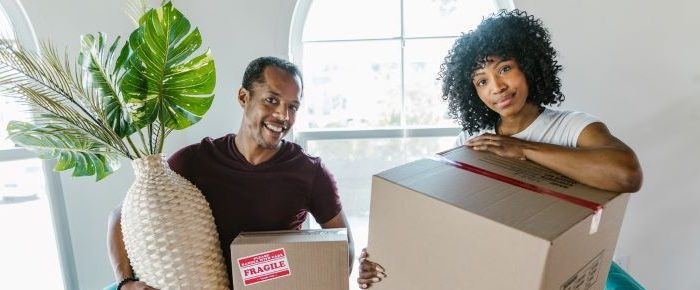 Couple with moving boxes.