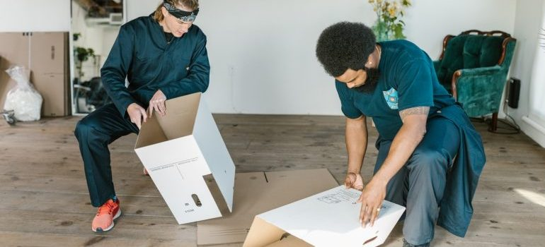 commercial movers Aventura FL assembling boxes