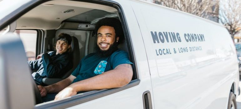 Two professional movers in a van