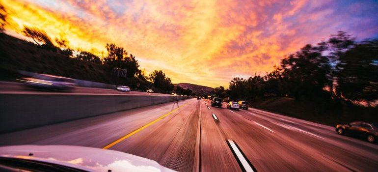 A speeding car on a highway.