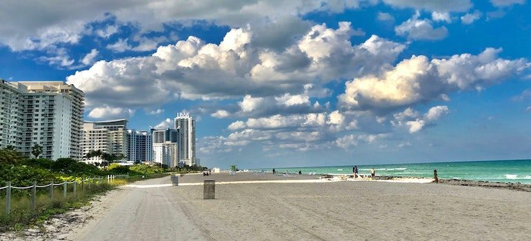 A beach with sea nad buildings is where you start looking for local moving companies Miramar FL