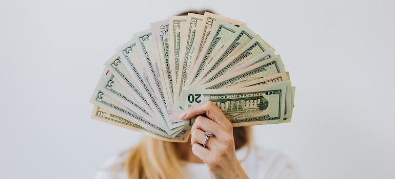 faceless woman holding money