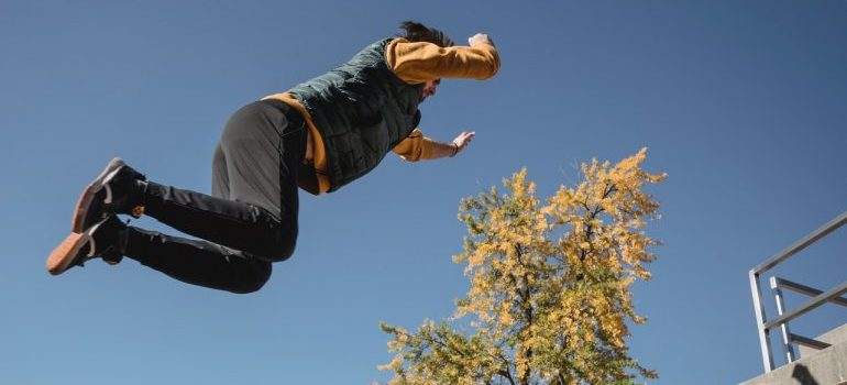 A person mid-leap.