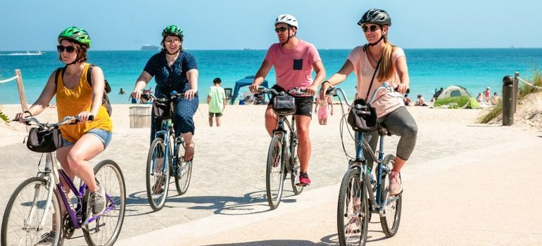 people driving bikes on a beach