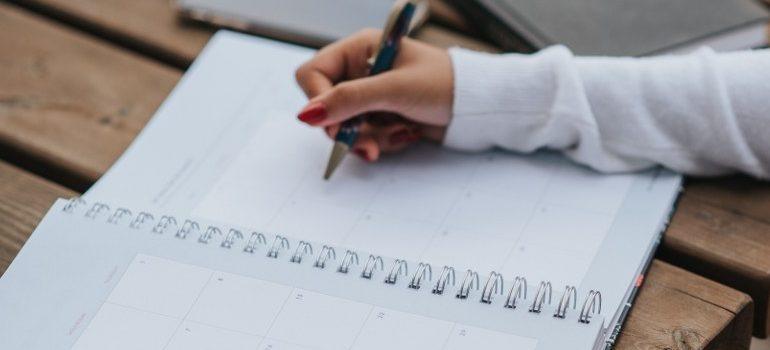 person creating a checklist