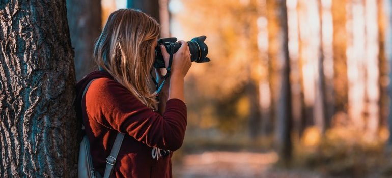 woman using a camera to take a picture