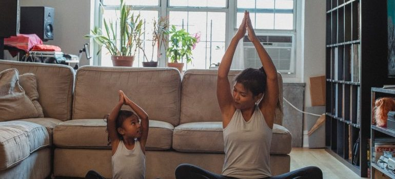 mother and daughter donig yoga