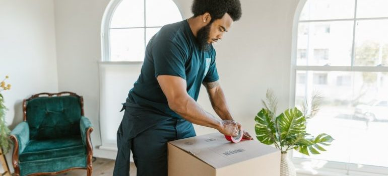 mover packing items into a moving box