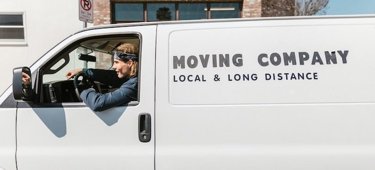 a moving van and a man driving it