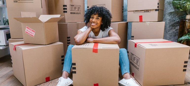 woman surrounded with boxes