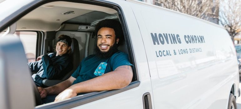 Two man in a van are part of local movers Palm Bay