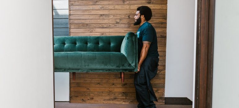 commercial movers Delray Beach FL carrying a sofa