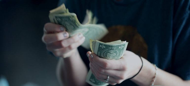 A person counting money in his hands