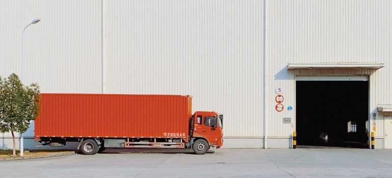 a moving truck entering a warehouse