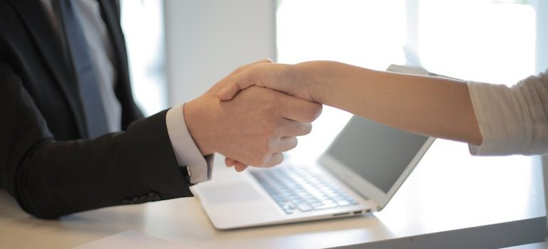 handshake with a computer in background