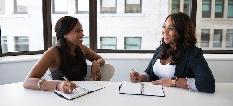 two women talking in an office