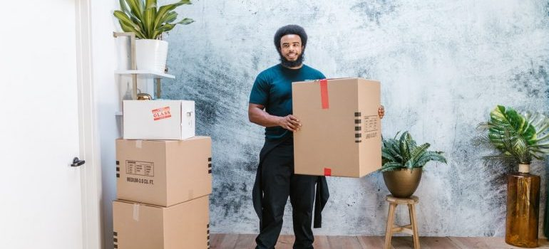 mover holding a cardboard box