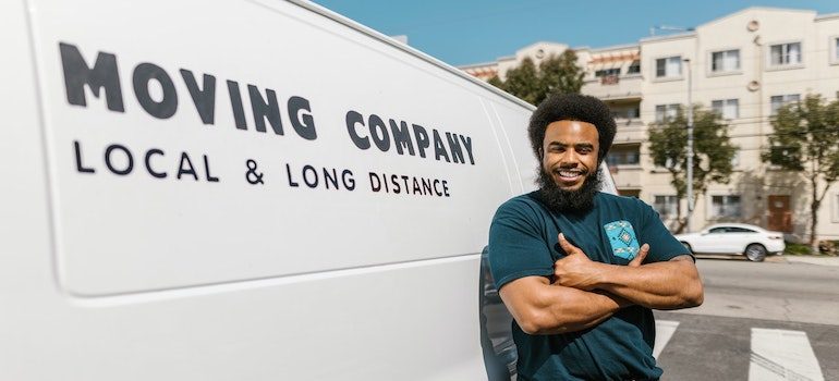 man standing next to a moving truck is part of best movers Spring Hill FL