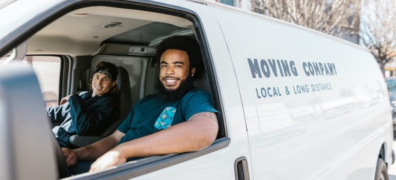 two men in a van are part of residential movers Lake City FL