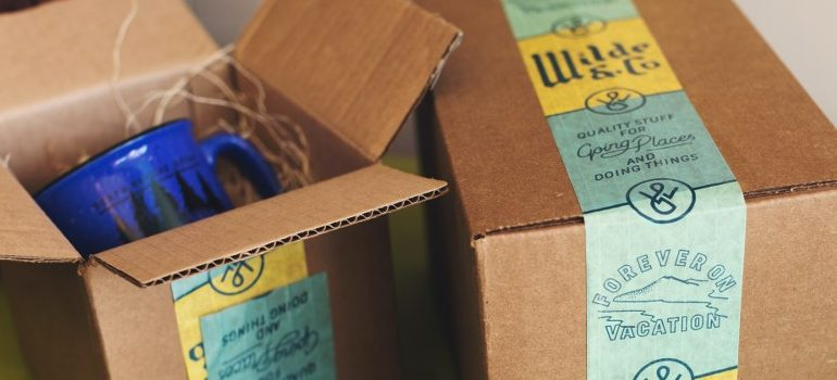 blue cup in a cardboard box