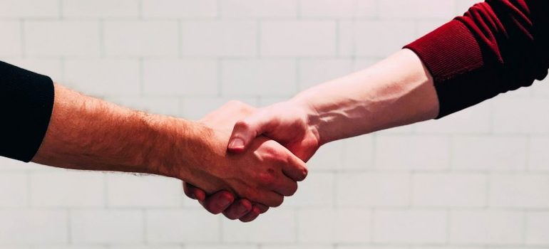 commercial movers Spring Hill FL shaking hands with a client