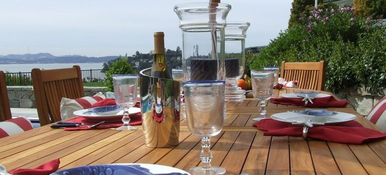 Restaurant table with plates, and glasses.
