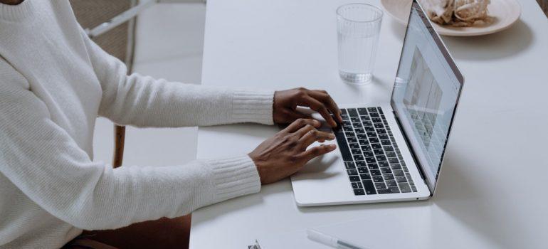 man booking residential movers Deerfield Beach on his laptop