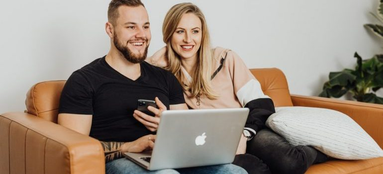 couple looking for moving companies Spring Hill on a laptop