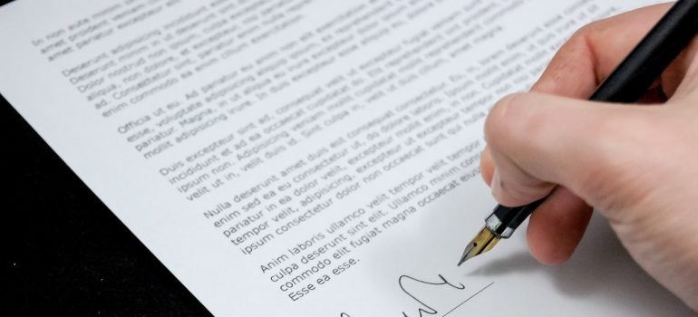 A man signing a document.