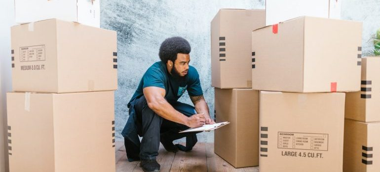 residential mover cataloging moving boxes