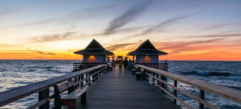 Pier with the sunset in the background.