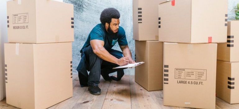 homestead fl movers inspecting packed boxes