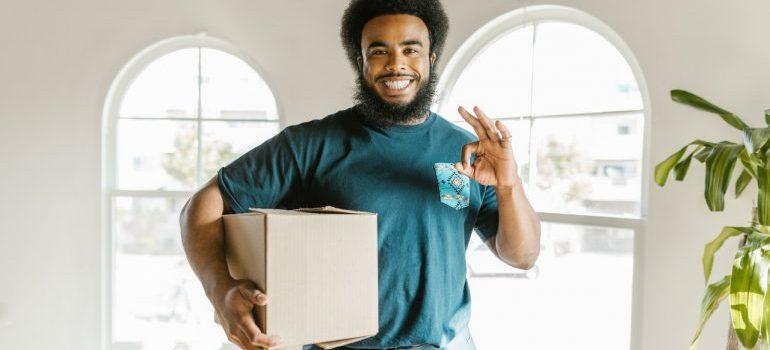 Bonita Springs mover holding a box