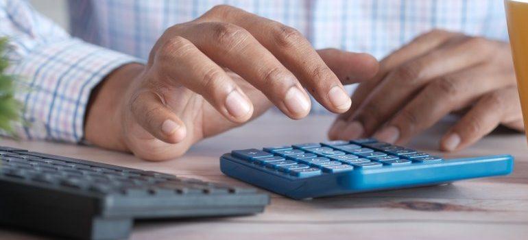 person using a blue calculator